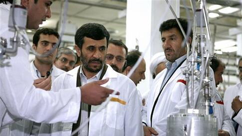 In this photo released by the Iranian President's Office, Iranian President Mahmoud Ahmadinejad, center, listens to a technician during his visit of the  Natanz Uranium Enrichment Facility some 200 miles (322 kilometers) south of the capital Tehran, Iran,