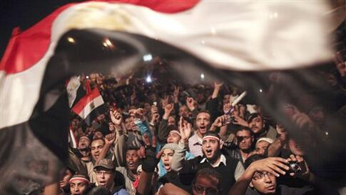 Egyptians celebrate the news of the resignation of President Hosni Mubarak, who handed control of the country to the military, Cairo, Egypt, Feb 11, 2011