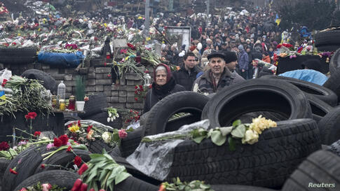 People mourn at a make-shift memorial for those killed in recent violence at Independence Square, Kyiv, Ukraine, March 2, 2014.