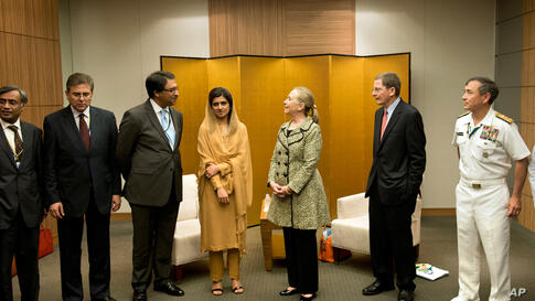 Secretary Clinton and Pakistan Foreign Minister Hina Rabbani Khar, center left, pose before a bilateral meeting in Tokyo, July 8.