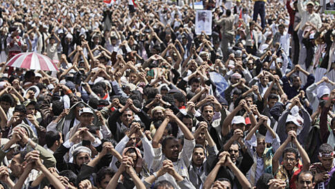 Anti-government protesters gesture during a demonstration demanding the resignation of Yemeni President Ali Abdullah Saleh, in Sana'a, Friday, June 10, 2011