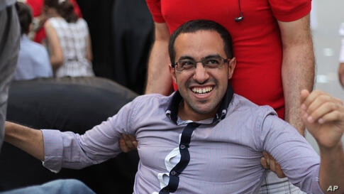 Mohamed Hassan, a well-known blogger and activist in Bahrain, is carried by friends and relatives at a celebration of his release from jail outside his home in Sitra. Hassan, who spent more than two months in jail, said he was released on bail and may ...