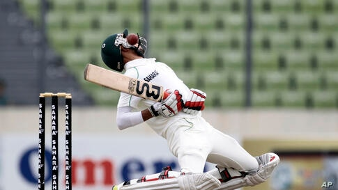 Bangladesh's Nasir Hossain avoids a bouncer on the second day of the second cricket test match against New Zealand in Dhaka, Bangladesh.