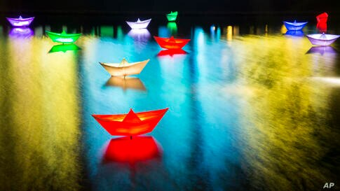 Lamps shaped as ships are seen in a water basin next to Potsdam Square during the first Berlin Light Festival in Berlin, Germany, Oct. 4, 2013.