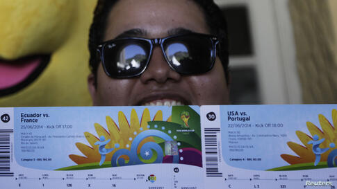 Brazilian soccer fan Anderson poses in front of the media after picking up his 2014 World Cup tickets in Rio de Janeiro. FIFA venue ticketing centers were opened in the World Cup host cities.