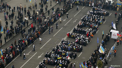 """Pro-European integration protesters form the Ukranian word """"Lustration"""" at Independence Square in Kyiv."""