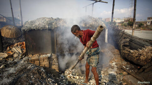 A man processes tannery wastes to make poultry feed at Hazaribagh along the polluted Buriganga river in Dhaka, Bangladesh.