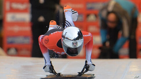 Austria's Janine Flock jumps on her skeleton during her first run in the women's Skeleton World Cup race in Innsbruck, Austria.