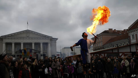 People watch a circus performance during the traditional Kaziukas fair, a large annual folk arts and craft fair in Vilnius, Lithuania, Mar. 7, 2014.