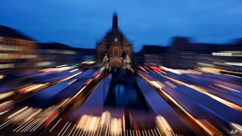In this picture taken with a long time exposure, the Church of Our Lady is photographed during the traditional opening of the world-famous Christmas market at the Old Town in Nuremberg, southern Germany.