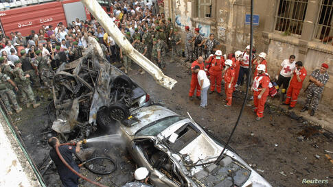 Lebanese Red Cross and civil defence personnel work at the site of an explosion in central Beirut, October 19, 2012.