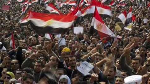 Thousands of Egyptian anti-Mubarak protesters shout slogans as they take part in a demonstration at Tahrir square in Cairo, Egypt, Tuesday, Feb. 8, 2011. (AP Photo/Emilio Morenatti)