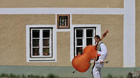 A young man carries his instrument during the oldest folklore festival of Europe in Straznice, south Moravia, 80 km southeast from Brno, Czech Republic.