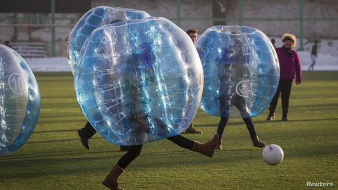 Participants play a game of bubble bump soccer during an amateur championship in Almaty, Kazakhstan, Jan. 11, 2014. The game is played by five-a-side teams wearing inflatable balls trying to score goals against the opposing team.