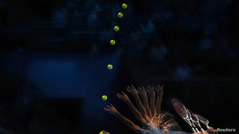 Roger Federer of Switzerland serves to Richard Gasquet of France during the men's singles tennis match at the ATP World Tour Finals at the O2 Arena in London.