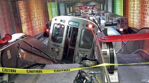 A Chicago Transit Authority train car rests on an escalator at the O'Hare Airport station after it derailed.