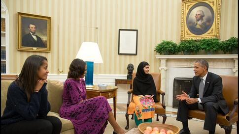 President Barack Obama, First Lady Michelle Obama, and their daughter Malia meet with Malala Yousafzai, the young Pakistani schoolgirl who was shot in the head by the Taliban a year ago, in the Oval Office, Washington, D.C.