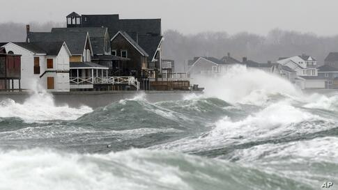 Wind-driven waves come ashore in Scituate, Massachusetts. Cape Cod and the islands were expected to bear the brunt of the spring storm that struck full force.
