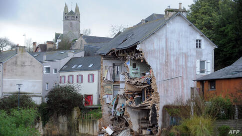 The facade of a house collapses due to floods after the Dirk storm in Quimperle, western of France.