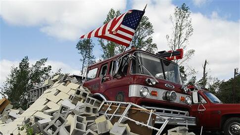Debris covers fire trucks at the Eoline Volunteer Fire Department near Centreville, Ala., Thursday, April 28, 2011, where a tornado struck the day before. Massive tornadoes tore a town-flattening streak across the South, killing at least 269 people in six