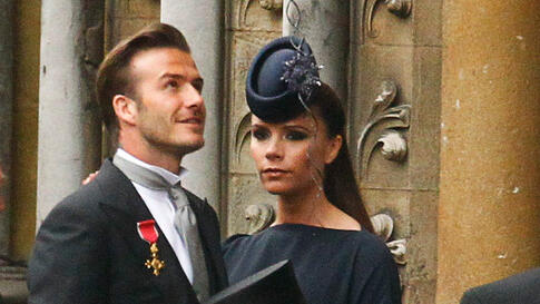 Soccer star David Beckham and his wife Victoria at Westminster Abbey for the royal wedding. (Reuters/Kai Pfaffenbach)