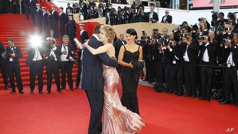 Actress Jane Fonda, center right, embraces actor Alec Baldwin during the opening ceremony and screening of Moonrise Kingdom at the 65th international film festival, in Cannes, southern France, May 16, 2012.