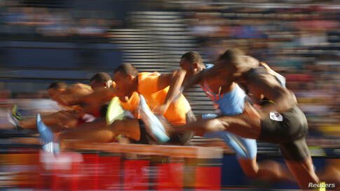 Competitors clear hurdles during a heat of the men's 110m hurdles during the IAAF Diamond League athletics meeting at Hampden Park in Glasgow, Scotland.