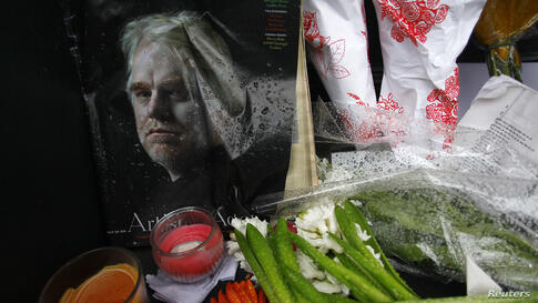 A memorial for movie actor Philip Seymour Hoffman is displayed in front of his apartment building in New York. The award-winning actor was found dead in his New York City apartment Sunday of an apparent drug overdose, according to a police department s...