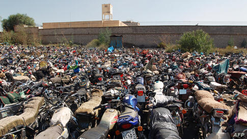 "Motorcycles that were seized at the police headquaters in Sana'a, Yemen, after their owners violated a 15-day ban on motorcycles. Yemen began enforcing a temporary ban on motorbikes in the capital to prevent ""shoot and scoot"" attacks as al-Qaida suspec..."