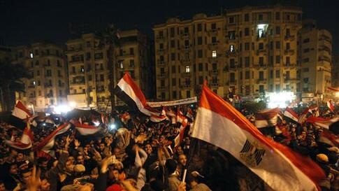 Egyptian citizens wave their national flags as they celebrate after President Hosni Mubarak resigned and handed power to the military at Tahrir Square, in Cairo, Egypt, Friday, Feb. 11, 2011. Egypt exploded with joy, tears, and relief after pro-democracy