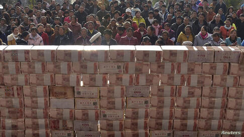 Villagers wait to collect their year-end bonus at Jianshe village, Liangshan, Sichuan province, China, Jan. 14, 2014. About 13,115,000 yuan ($2,169,221) were placed in the middle of a square before being distributed as bonus to around 340 villagers in ...