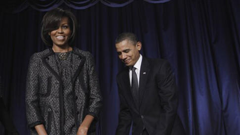 President Barack Obama pulls out a chair for first lady Michelle Obama as they arrive at the National Prayer Breakfast in Washington, Thursday, Feb. 3, 2011. (AP Photo/Charles Dharapak)