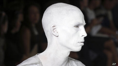 A model wears a creation for Rick Owens men's spring-summer 2015 fashion collection, presented in Paris, France.