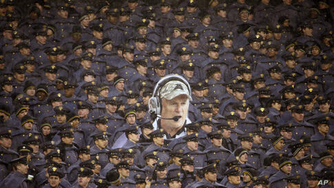 Army cadets hold a large photo of Army head coach Rich Ellerson during an NCAA college football game against Navy in Philadelphia, Pennsylvaina, Dec. 14, 2013. Navy won 34-7.
