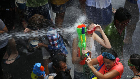 Revellers take part in a water fight during Songkran Festival celebrations on Silom Road in Bangkok, Thialand.