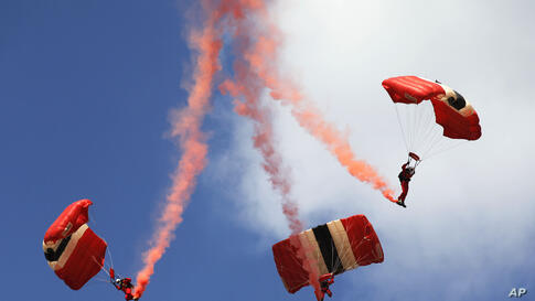 The British Army's Parachute Regiment display team, the Red Devils, performs during the Farnborough International Air Show, Farnborough, England.