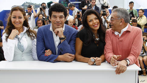 From left, actors Menna Shalaby, Bassem Samra, Nahed El Sebai, and director Yousry Nasrallah pose during a photo call for After the Battle at the 65th international film festival, in Cannes, France, May 17, 2012.