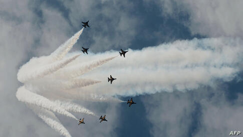 A South Korea Air Force aerobatic team, Black Eagles, flies in formation during a media preview ahead of Singapore's Airshow. Asia's top aerospace and defense show opens on February 11.