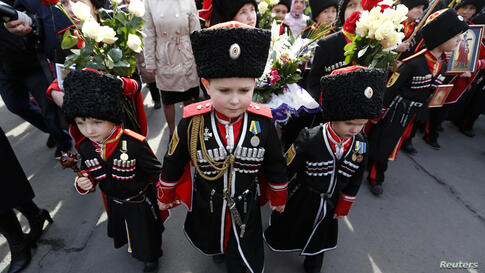 Children take part in a religious procession to mark the Palm Sunday in St. Petersburg, Russia.
