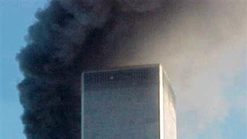 ** FOR USE AS DESIRED WITH SEPT. 11 ANNIVERSARY STORIES--FILE **A jet airliner is lined up on one of the World Trade Center towers in New York, in this Sept. 11, 2001,file photo. In the most devastating terrorist onslaughts ever waged against the United S