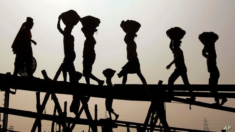 Bangladeshi laborers unload coal from a boat, on the last day of a four-day blockade called by the opposition in Dhaka.