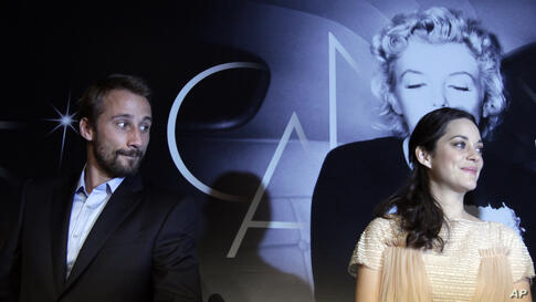Actors Matthias Schoenaerts and Marion Cotillard arrive for a press conference for Rust and Bone at the 65th international film festival, in Cannes, France, May 17, 2012.