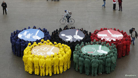 Olympic rings are displayed in Paris, France, with images against restriction of speech and freedom of information, repression of demonstrations, discrimination due to sexual orientation and migrant's exploitation, as part of a protest by human rights ...