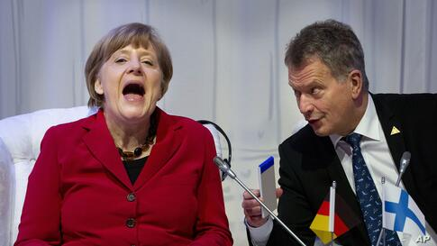 German Chancellor Angela Merkel, laughs talking to Finland's President Sauli Niinisto as they attend an informal plenary session on the last day of the Nuclear Security Summit (NSS) in The Hague, Netherlands.