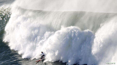 A surfer rides a wave during the Punta Galea Big Wave Challenge in Punta Galea, northern Spain, Dec. 22, 2013.