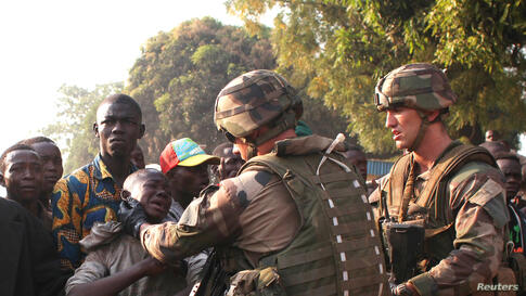 French military personnel try to control supporters who are asking them to disarm fighting gangs, near the airport in Bangui, Central African Republic. France appealed to European partners for assistance in quelling months of religious violence in its ...
