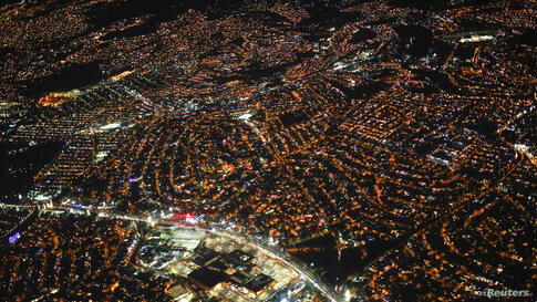 An aerial view of Mexico City at night, Dec. 16, 2013