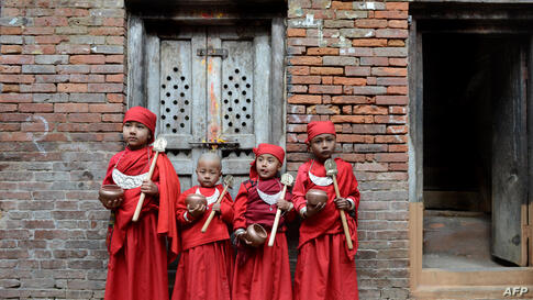A group of Nepalese Buddhist boys are seen before they attend Bratabandha, a coming-of-age ceremony, in Kathmandu.