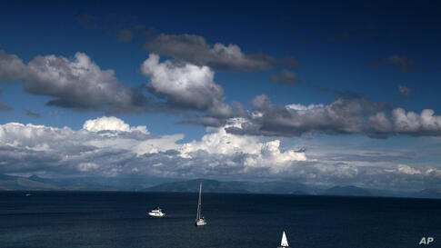 Boats sail in the bay of the Ionian island of Corfu, Greece, May 5, 2014.