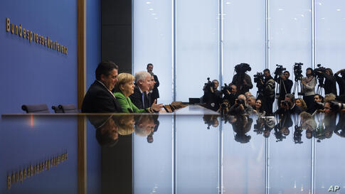 From left, German Social Democratic Party (SPD), chairman Sigmar Gabriel, Chancellor and chairwoman of the Christian Democratic Union (CDU), Angela Merkel and the chairman of the Christian Social Union (CSU), Horst Seehofer brief the media at a news co...